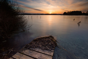Beautiful sunset over calm lake in Mazury lake district. After sunset sky reflecting in water