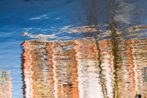 Close up of water surface with ripples. sky with clouds