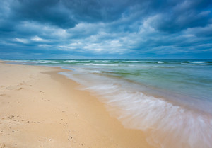 Beautiful view on Baltic sandy coast photographed on middle of the day. tranquil landscape