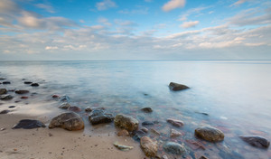 Beautiful long exposure landscape of rocky sea shore. Tranquil scene of Baltic sea near Gdynia in Poland.