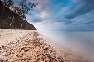 Beautifu rocky sea shore at sunrise or sunset. Long exposure landscape. Baltic sea near Gdynia in Poland.