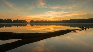 Beautifulsunrise over lake. Summertime tranquil landscape.