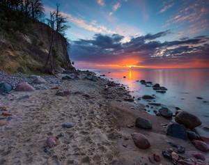 Beautiful Baltic sea shore with big cliff in Gdynia Orlowo. Seashore long exposure photo.
