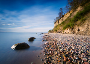 Beautiful Baltic sea shore with big cliff in Gdynia Orlowo. Seashore long exposure photo.--