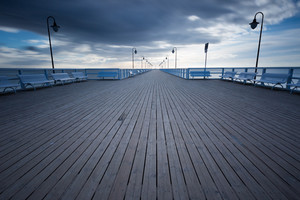 Beautiful pier in Gdynia poland. Seascape with wooden molo in Orlowo. Landscape with long exposure effect