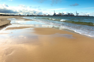 Beautiful sandy sea shore. Baltic sea. Long exposure photo.