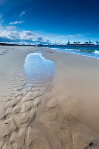 Beautiful sandy sea shore. Baltic sea. Long exposure photo.
