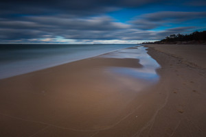 Baltic shore photographed on long exposure. Dark dramatic seascape of polish shore of Baltic sea.