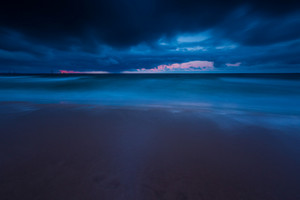 Baltic shore photographed on long exposure. Dark dramatic seascape of polish shore of Baltic sea.