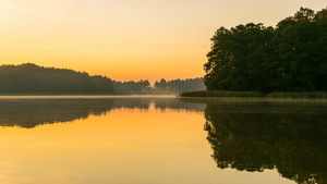 Beautifulsunrise over lake. Summertime tranquil landscape.