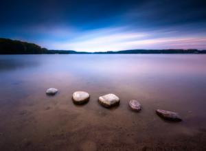 Long exposure landscape of polish lake shore. Lake Krzywe in Olsztyn