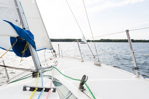 Beutiful Mazury lake photographed from yacht.-Front part of yacht swimming on lake.