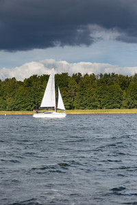 Yacht or boats on beautiful lake in Mazury lake district. Mamry lake in Poland with sailboats photographed i early autumn.
