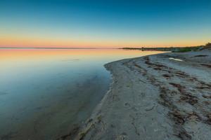 Beautiful beach before sunrise. Landscape of gdanska bay photographed on Jastarnia in Poland