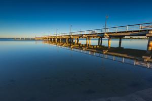 Beautiful wooden pier on Baltic sea shore. Wooden molo in Jastarnia on Hel peninsula.