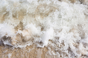 Close up of sea waves splashing on shore. Beautiful natural background of sea waves