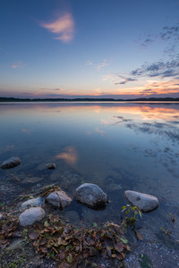 Beautiful summer sunset over lake in Poland. Mazury lake district in summer landscape