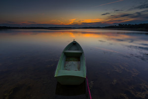 Beautiful lake sunset with fisherman boats. Polish lake in Mazury lake district. Polish lake landscape--