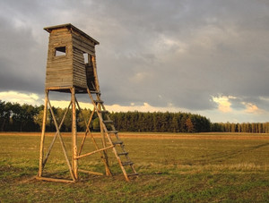 Sunset sky and raised hide. Polish calm landscape