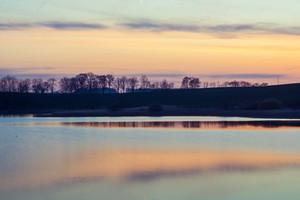 After sunset sky over beautiful polish lake
