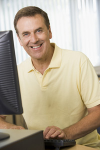 Middle aged man working on a computer