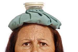 Middle-aged Woman With Ice Pack for Headache
