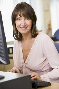 Middle aged woman working on a computer