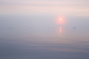 Misty sunrise over the icy ocean