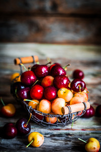 Mix Of Cherries On Wooden Background