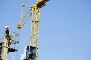 mobile cranes and workers in construction industry