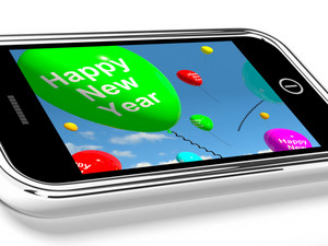 Mobile With Happy New Year Message On Screen