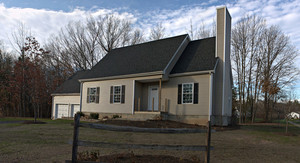 Modern custom built residential home newly constructed with a 2 car garage in a residential neighborhood.