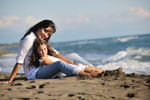 Mom And Daughter Portrait On Beach