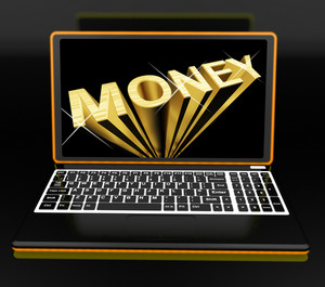 Money On Laptop Showing Earnings