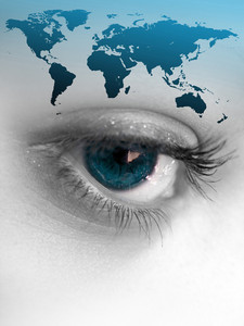 Montage of a pretty color isolated eye with the world continents.  This works for a variety of concepts from travel, to business, or even environmental issues.