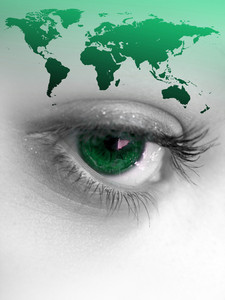 Montage of a pretty color isolated eye with the world continents.