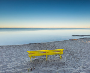 Morning seascape with bench on sea shore. Beautiful landscape taken in Jastarnia