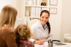 Mother and child girl visit pediatrician office healthcare specialist