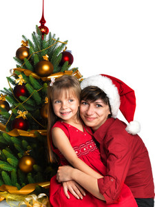 Mother and daughter near the Christmas tree