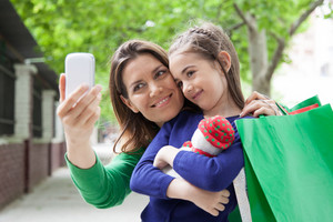 Mother and daughter pulling a photo