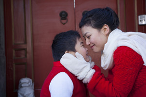 Mother and son dressed in holiday attire
