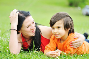 Mother and son on meadow, happy time