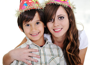 Mother and son wearing birthday hats
