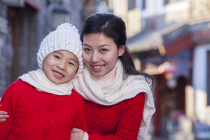 Mother with child dressed in holiday attire