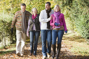 Multi-generation family enjoying walk through autumn woods