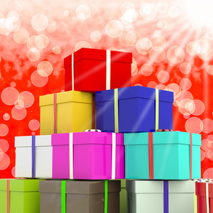 Multicolored Giftboxes  With Bokeh Background As Presents For The Family