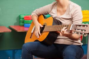 Music teacher in the kindergarten