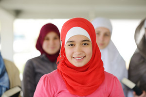 Muslim and Arabic girls standing together in line row