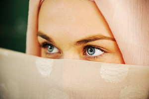 Muslim Arabic teenage student inside the high school classroom posing