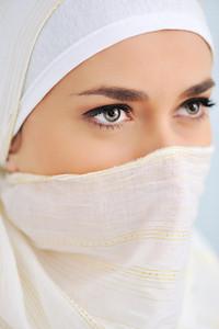 Muslim beautiful woman with scarf and veil, closeup